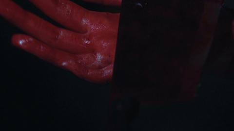 Trembling bloody hands holding wide knife, victim kills offender, self-defence Footage