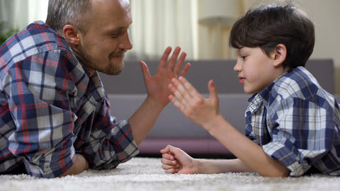 Caring dad praising his little son, fathers care and support, time together Live Action