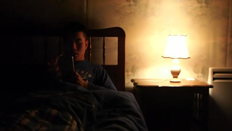 Man is Browsing Internet on Phone at Night Live Action