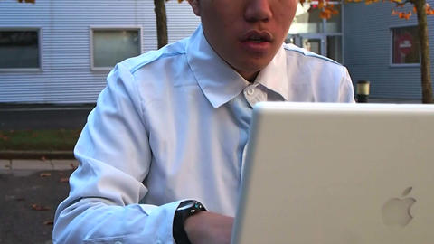 Businessman Working on Laptop Computer Live Action