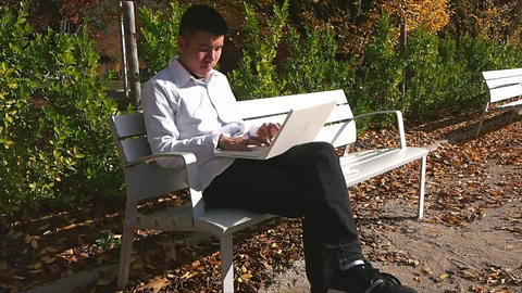 Businessman With Laptop in Park Footage
