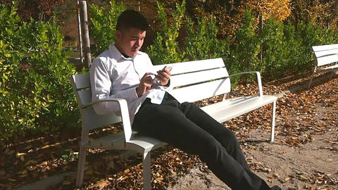 Businessman With Phone in Park Live Action