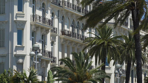 Hotel building with palm trees on coastline Nice, French architecture, tourism ビデオ