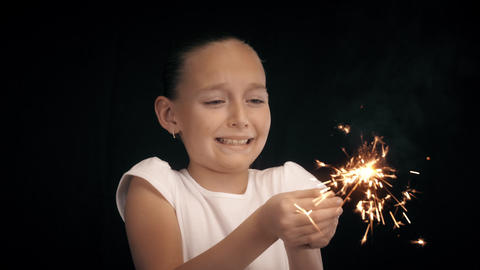 Teenager girl keep in hands burning bengal light and happy laughing with sparks Footage