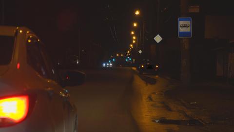 Flashing alarm lights of a car standing on night street Footage