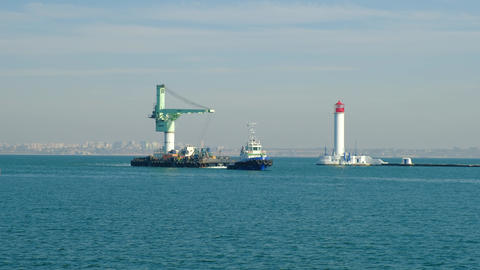 Towing a floating crane. Sea towing boat sails near the port of Odessa beacon 영상물
