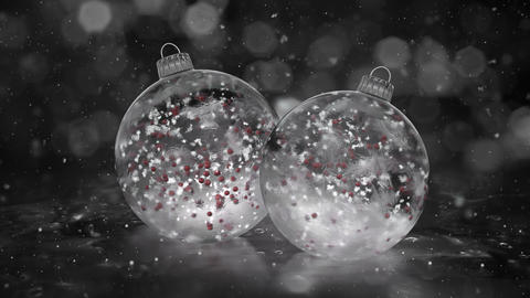 Two Rotating Christmas White Ice Glass Baubles snow red balls background loop Animation