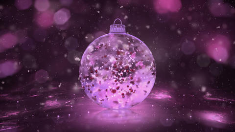 Christmas Rotating Pink Ice Glass Bauble snow colorful petals background loop Animation