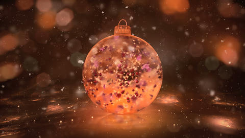 Christmas Rotating Golden Ice Glass Bauble snow colorful petals background loop Animation