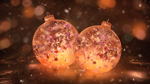 Two Rotating Christmas Gold Ice Baubles snow colorful petals background loop Animation