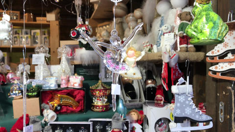 Ballet dancer decoration hanging by thread at Christmas fair Footage