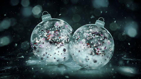Two Christmas Grey Noir Ice Glass Baubles snow colorful petals background loop Animation
