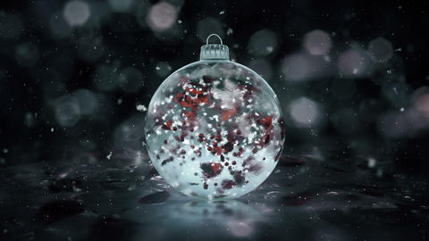 Christmas Rotating Grey Noir Ice Glass Bauble snow red petals background loop Animation