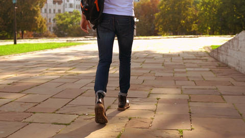 male with knapsack use smartphone stroll in city GIF
