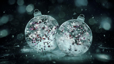 Two Rotating Christmas Grey Noir Ice Baubles colorful petals background loop Animation