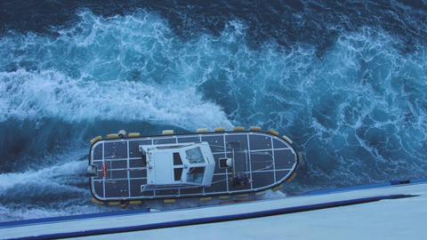Pilot boat near side of big ferryboat. Top view of motorboat and bow wave on sea Live Action