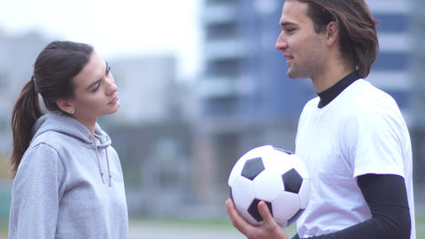 Active young girl and guy in sportswear Young guy and girl in sportswear Live Action