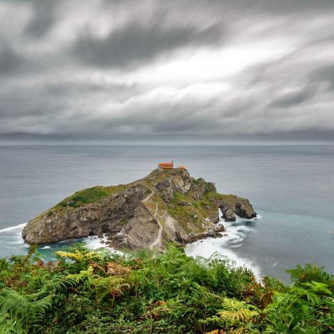 San Juan de Gaztelugatxe islet and dramatic sky フォト