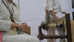Woman is spinning wool on a spinning wheel 9 Live Action