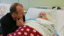 Man is visiting old, ill lady in hospital Footage