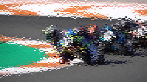 Many motorbikes competing in a racing circuit and slow-mo Live Action