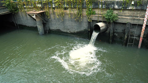 Rain water flows from the sewer pipe after the downpour, the concept prevents Footage