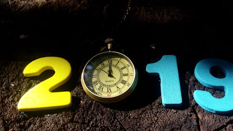 New Year 2019. Christmas. Colored numbers on a Wooden background with golden Live Action