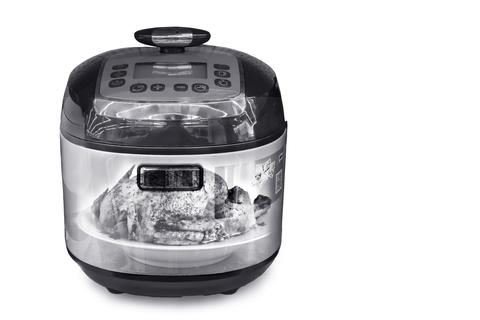 The slow cooker on a white background. The double exposure effec フォト