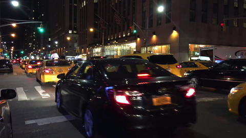 NEW YORK CITY – OCTOBER 2015: Manhattan Traffic at Night. New York traffic is  Live Action