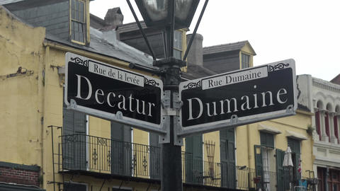 Street signs Decatur street and Dumaine street in New Orleans Live Action