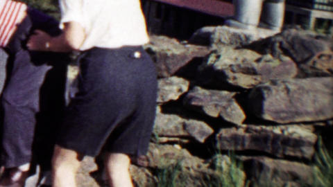 1959: Boy has trouble climbing bear statue mom helps Footage