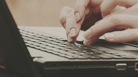 Close-Up Of Female Hands Using Laptop Footage