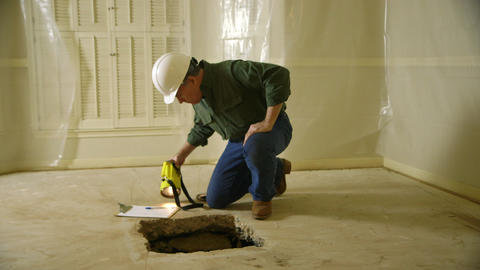 Inspector checking a slab issue inside the house Live Action