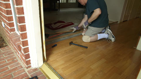 DYI project of removing old laminate flooring Footage