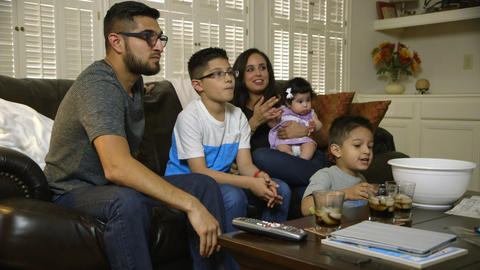 young hispanic family watching tv Footage