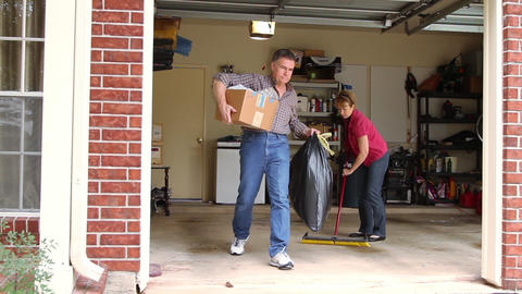 husband and wife cleaning garage Footage