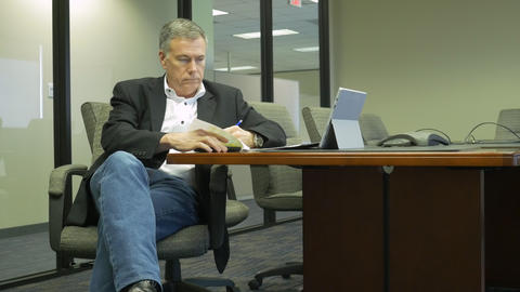 businessman going over paperwork in a conference room Footage
