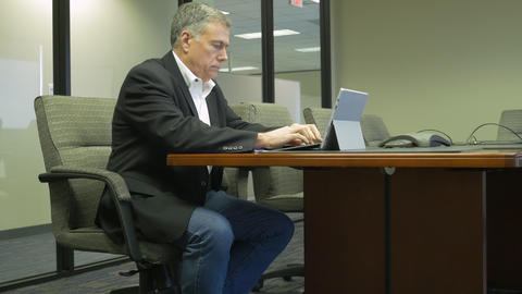 businessman in a corporate conference room Footage