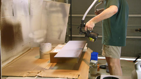 woodworker painting boards for the home renovation Footage