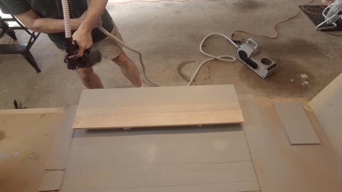 Woodworker painting a board using a HVLP sprayer Live Action