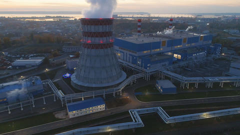 aerial view heating station and tower with rising steam GIF
