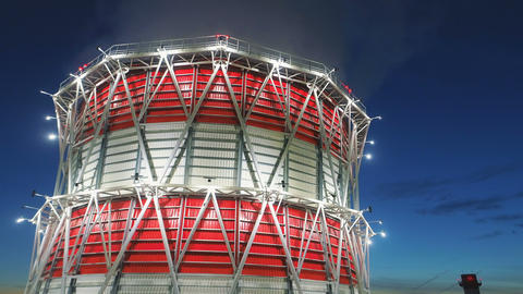 bird eye view cooling tower at led light and dawn above city GIF