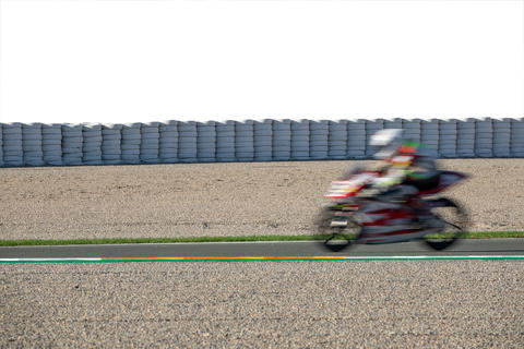 Blurred motion of moborbike competing in racing circuit and white space Photo