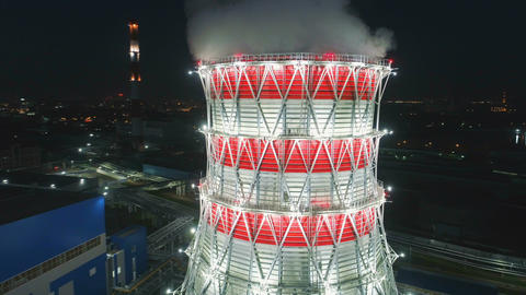 aerial motion around cooling tower at bright projector light Footage