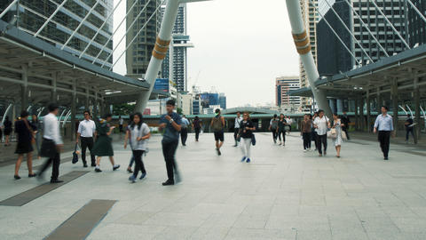 Time lapse view of pedestrians on the busy footbridge at rush hour in downtown Live Action