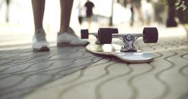 Longboard in upside down on a concrete ground 영상물