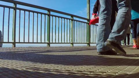 Legs of Big Crowd Walking On A Tall Bridge Footage