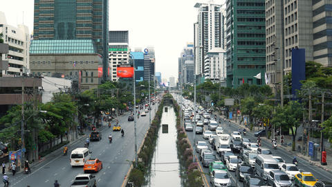 Street traffic in Bangkok downtown, traffic jam at day rush hour Live Action