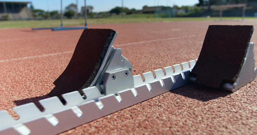 Close-up of starting blocks on a running track 4k Live Action
