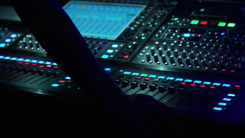 Soundman Working on the Mixing Console Live Action